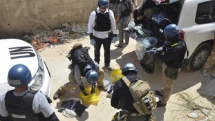 UN chemical weapons experts collecting samples in Syria.