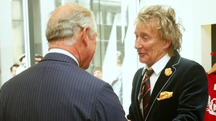 Prince of Wales smiles as he speaks with Rod Stewart and Penny Lancaster