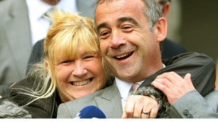 Coronation Street actor Michael Le Vell smiles with his sister Sue after he was cleared of all charges.