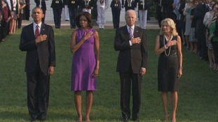 The Obamas and the Bidens observe a moment of silence outside the White House.