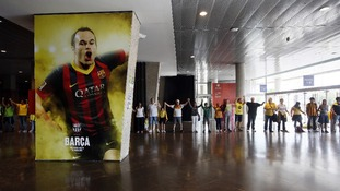 Catalan separatists form a human chain through the Nou Camp stadium in Barcelona