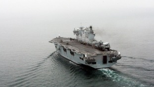 HMS Ocean heads towards the River Thames for Greenwich