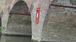 The unsolved mystery of the postbox on a bridge