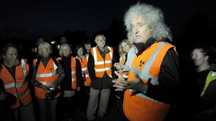 Queen guitarist Brian May addresses members of a Wounded Badger Patrol in Gloucestershire