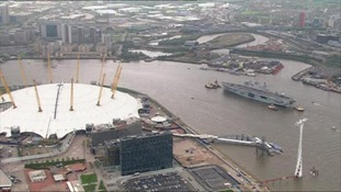 HMS Ocean passes the O2 arena.