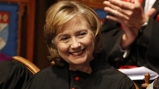 Clinton smiles as she receives an honorary degree from St Andrews University