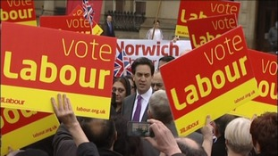 Labour leader Ed Miliband among the placards