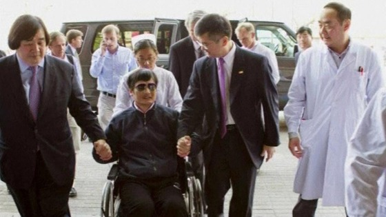 Chen Guangcheng in a wheelchair arriving at a Beijing hospital on Wednesday