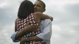 US President Barack Obama embraces wife Michelle Obama