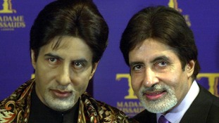 Amitabh Bachchan, one of the stars of Sholay, poses with his waxwork at Madame Tussauds