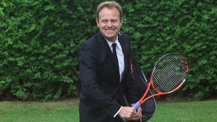 Racket and case held by Jason Donovan