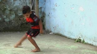A child practicing Passinho in Rio de Janeiro