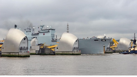 HMS Ocean passes through the Thames Barrier.