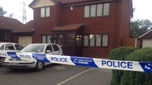 Police tape surrounds the house in Victory Road