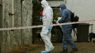 Forensic experts inspect the scene of the shootings.