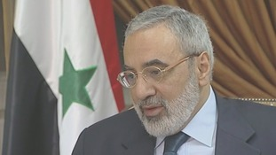 Syria's information minister Omran al-Zoubi speaks to ITV News' Bill Neely.