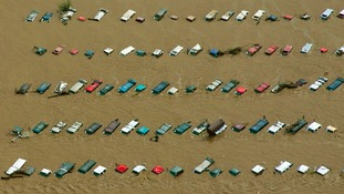 An aerial view of vehicles submerged in flood waters near Greenley, Colorado.