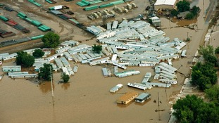 An aerial view of mobile homes submerged in flood waters near Greenley, Colorado.