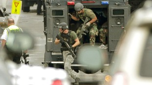 Member of a SWAT team deploy at the Navy base in Washington