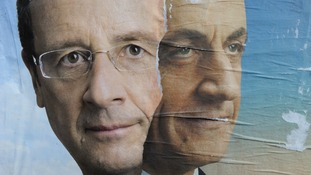 Official campaign posters for Nicolas Sarkozy (R) and Francois Hollande.
