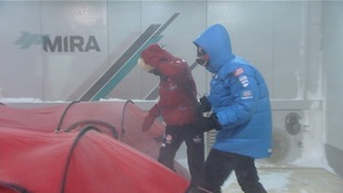 Two members of the team battle the wind in the chamber.