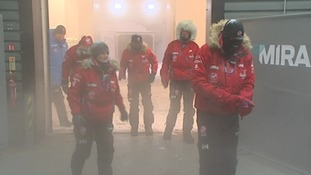 Coming out from the cold, the team emerge from the cold chamber.