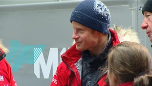 Still covered in ice Prince Harry warms up after the freezing temperatures inside the cold chamber.