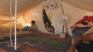 Inside Um Shadi Bardan's tent at Zaatari refugee camp