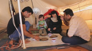 Um Shadi Bardan and her family in their tent