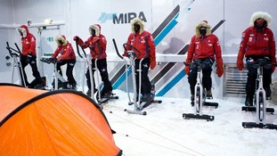 Prince Harry and the team practice skiing in the cold chamber.