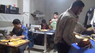 Volunteers at work in a home-based factory in eastern Damascus