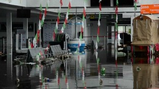 The airport buildings are flooded stranding tourists.