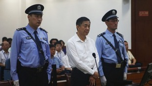 Disgraced Chinese politician Bo Xilai stands trial inside the court in Jinan, Shandong province.