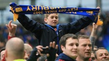 Young fan celebrates Shrewsbury Town's promotion