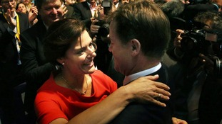 Clegg is greeted by his wife Miriam after delivering his keynote speech.