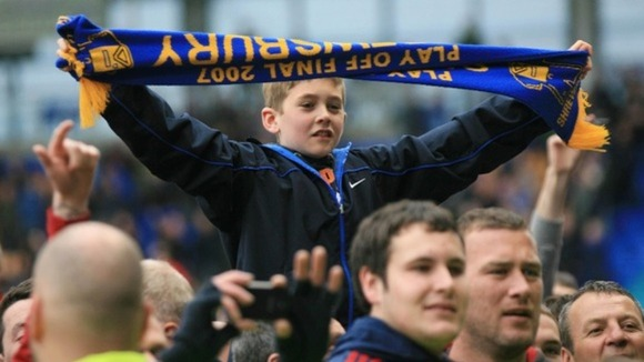 Young fan celebrates Shrewsbury Town&#x27;s promotion