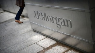 Investment bank JP Morgan has been fined £572 million ($920 million) by UK and US regulators.