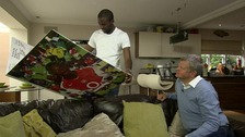Fabrice Muamba shows Adrian Chiles the card his former Arsenal team-mates made him.