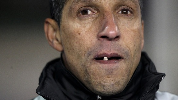 Chris Hughton watches his Birmingham team play football