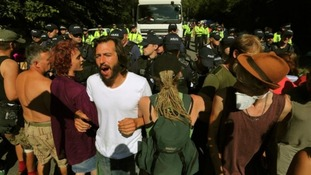Anti-fracking demonstrators form a human chain to slow down lorry at the protests in Balcombe, West Sussex.