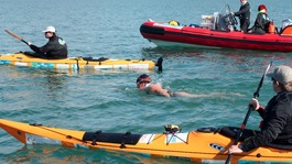 Swimmer Anna Wardley with support boats