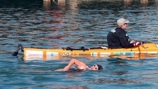 Anna Wardley with a support boat during her round the island swim