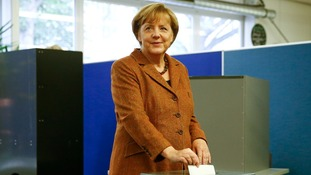 German Chancellor and election candidate Angela Merkel casting her vote