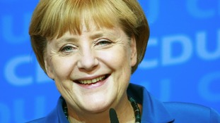 German Chancellor Angela Merkel reacts to first results of the 2013 German federal elections.