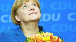 German Chancellor Angela Merkel reacts to first results of the 2013 German federal elections