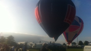 Hot air balloons in the evening light at the Royal Berkshire Show