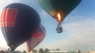 Hot air balloons flying above the Royal Berkshire Show
