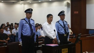 Disgraced Chinese politician Bo Xilai standing trial inside the court in Jinan, Shandong province.