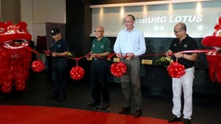 Anthony Phillipson, second from left, helps open the Singapore showroom