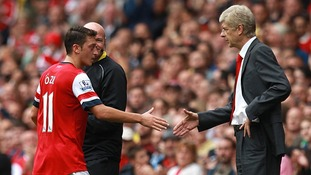 Mesut Ozil shakes hands with manager Arsene Wenger after being substituted